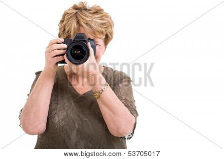 senior female amateur photographer taking photos isolated on white
