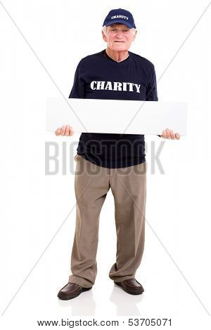 mature charity worker holding blank banner isolated on white background