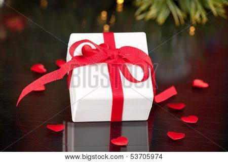 Gift With Red Ribbon With Hearts