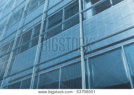 Abstract Facade Of Modern Office Building With Windows And Metal Grid