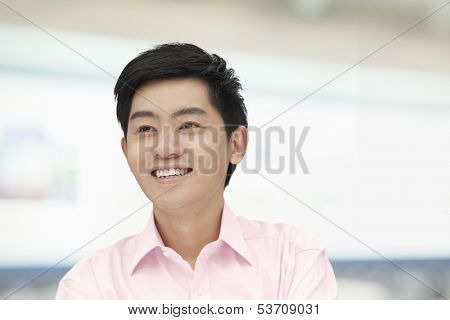Portrait of young man in pink button down shirt