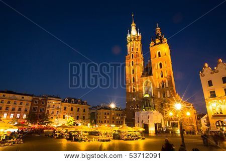 KRAKOW, POLAND - OCT 19: St. Mary's Church in historical center of Krakow, Oct 19, 2013 in Krakow, Poland. This year the city was visited by more 8.1 million tourists, which is the highest level.