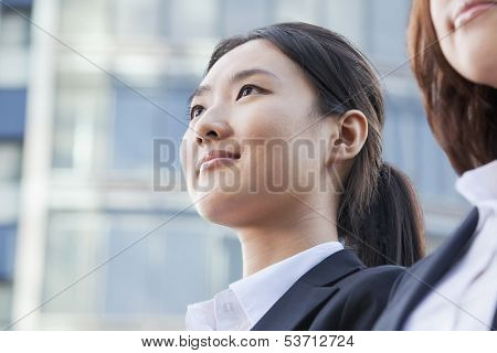 Two businesswomen in front of cityscape
