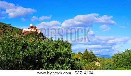 view of Shrine of Mare de Deu de la Roca, in the top of a hill, in Mont-roig del Camp, Spain