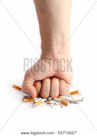 Man's Fist Crushing Cigarettes