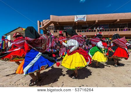 PUNO, PERU - JULY 25: musicians and dancers in the peruvian Andes at Taquile Island on Puno Peru at july 25th, 2013. The highest point of the island is 4050 masl and the main village is at 3950m