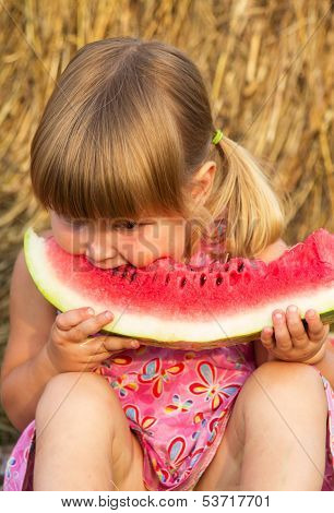 Girl eat sweet and tasty water-melon