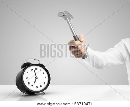 Hand smashing the alarm clock