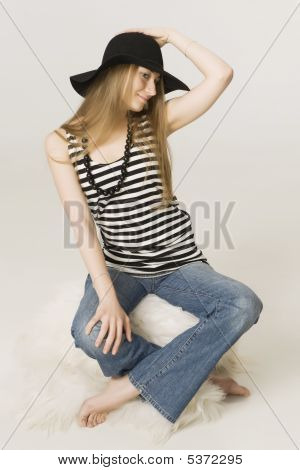 Girl Blonde In A Funny  Black Hat