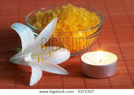 Bath Salt And White Lily On Bamboo Mat In Light Of Aroma Candle