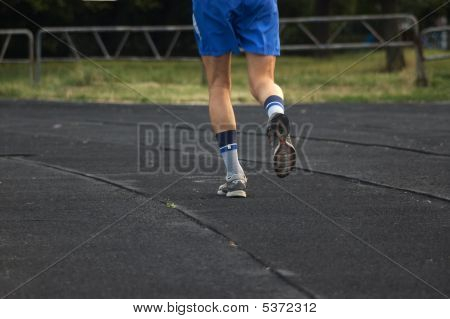 Runner Running At Stadium