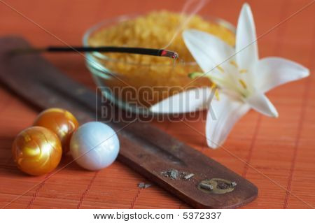 Incense Stick, Bath Salt And White Lily On Bamboo Mat