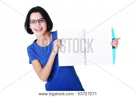Attractive woman holding workbook in front, copy space. Isolated on white.