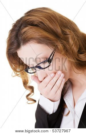 Business woman covering her mouth in nausea.