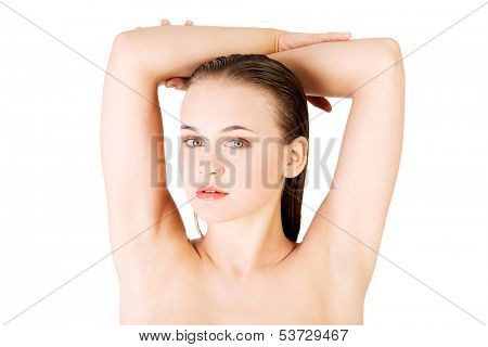 Attractive naked woman with her hands above head. Isolated on white.
