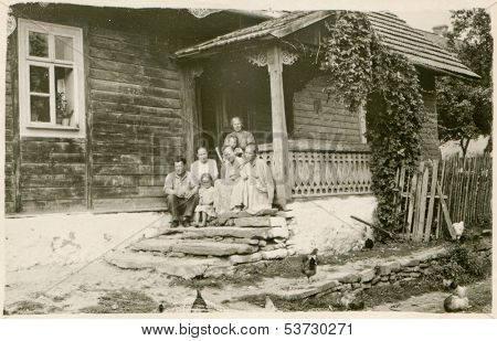 ANIELIN, POLAND, CIRCA FIFTIES - vintage photo of family posing on farm, Anielin, Poland, circa fifties