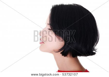 Profile of a woman with closed eyes. Side view. Isolated on white.