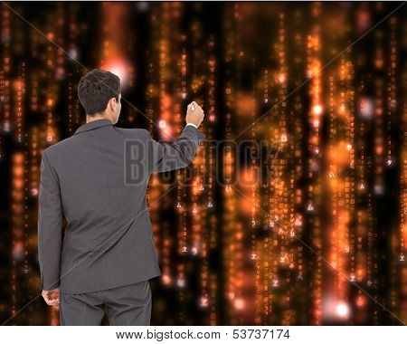 Composite image of businessman standing back to camera writing with marker