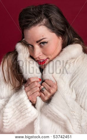 Coy Pinup Girl In Fur Coat