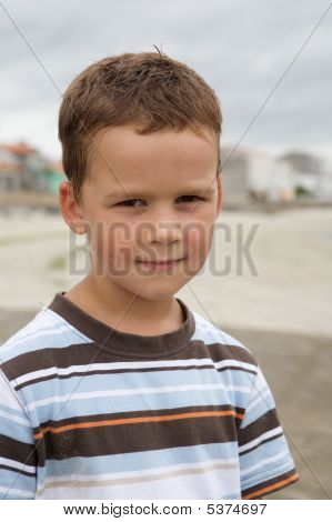 Pretty Little Boy On Beach