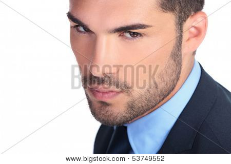 closeup picture of a serious young business man's face on white background
