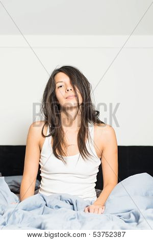 Tired Young Woman Waking Up After Sleep