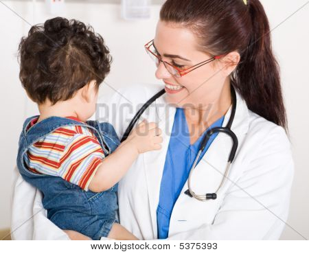 Lovely Paediatrician Holding Baby