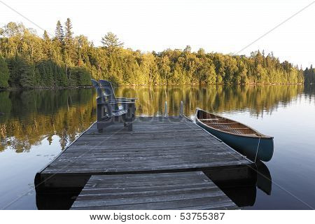 Canoe Tied To A Dock