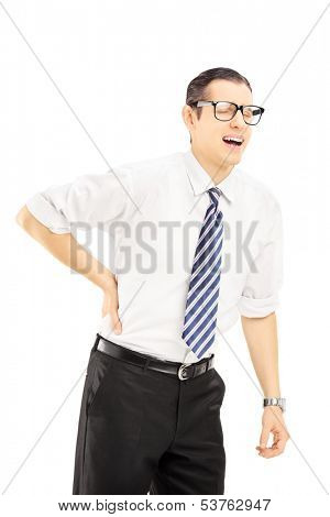 Young man with tie suffering from a back pain isolated on white background