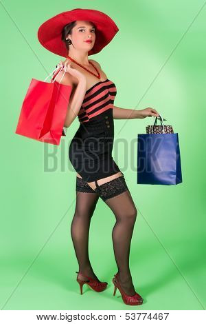 Elegant pin up girl with red hat and shopping bags