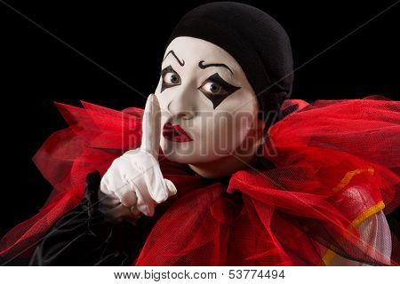 Funny Pierrot with her finger against her mouth