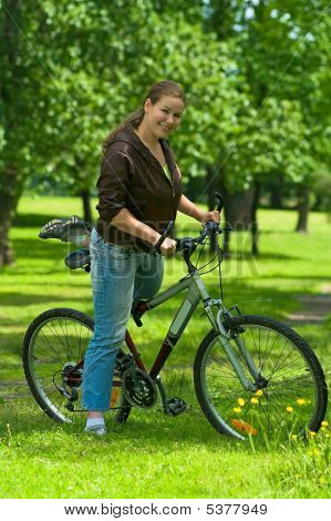Woman Bicyclist On The Bike