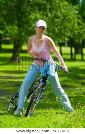 Woman Get Ride On The Bike