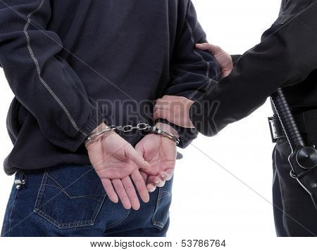Handcuffed man being escorted by the policeman