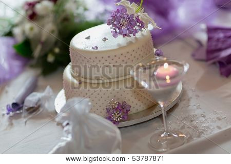 Traditional wedding cake with purple flowers
