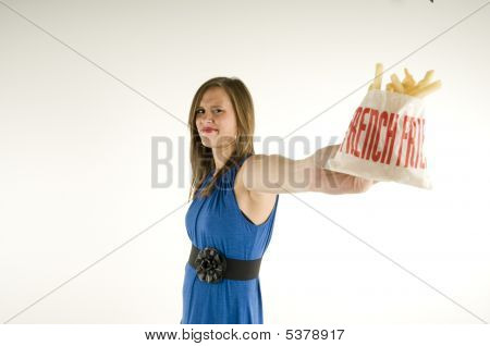 Skinny Girl Holding Bag Of French Fries