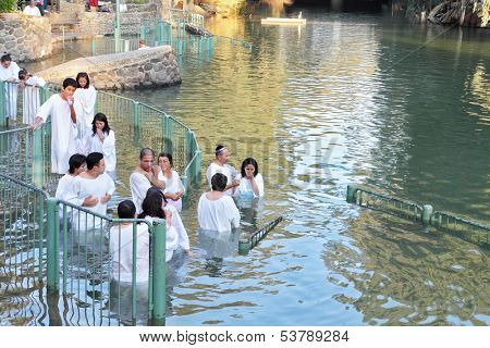Yardenit, Israel - January 21: The ritual baptism of Christian pilgrims in the sacred waters of the Jordan River in the days of the Feast of Holy Baptism 21 January 2012 Yardeniti, Israel.