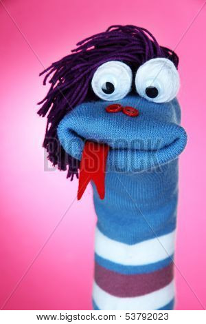 Cute sock puppet on pink background