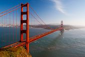 stock photo of gate  - A view at midday thru the Golden Gate Bridge towards downtown San Francisco - JPG