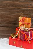 stock photo of superimpose  - several parcels of gifts for christmas are superimposed - JPG