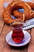 image of bagel  - a glass of black tea and turkish bagel on a wooden table - JPG