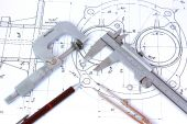 Micrometer Caliper Mechanical Pencil and Compass on Blueprint
