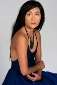 stock photo of filipina  - Pretty young Filipina in a spaghetti strap blue dress - JPG
