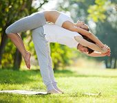 stock photo of yoga instructor  - Couple Yoga - JPG