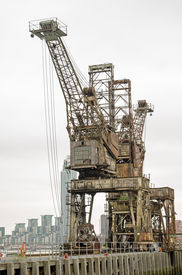 picture of coal barge  - Two cranes used to haul coal from barges on the River Thames at the disused Battersea Power Station - JPG