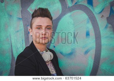Pretty Short Hair Girl Posing Against A Wall