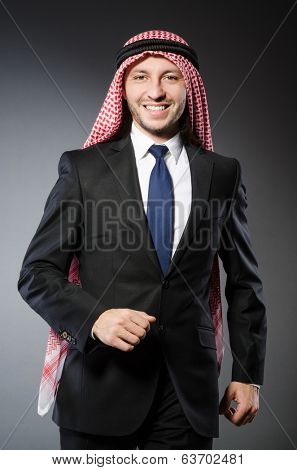 Arab businessman againt grey background