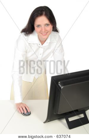 Female Office Worker Standing Behind Her Desk