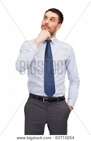business and office concept - handsome buisnessman looking up