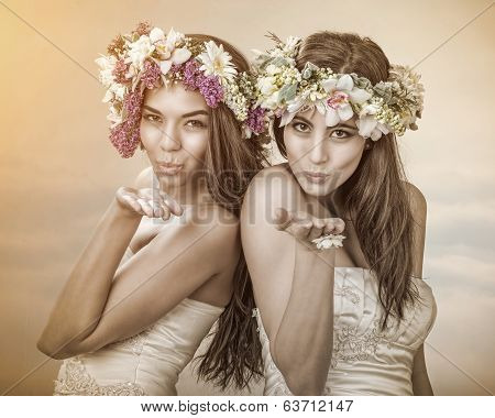 Two beautiful spring fairy brides sending a kiss to you